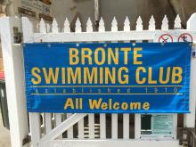 Bronte Swimming Club banner on fence